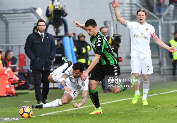 AC Milan's midfielder Joaquin Fernandez vies with Sassuolo's defender Cristian Dell'Orco during the Italian Serie A football match between Sassuolo...