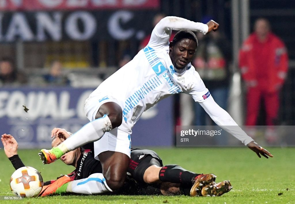 AC Milan's midfielder Luca Antonelli (REAR) fights for the ball with Rijeka's forward Maxwell Acosty during the UEFA Europa League Group D football match between HNK Rijeka and AC Milan at The Rujevica Stadium in Rijeka on December 7, 2017. /
