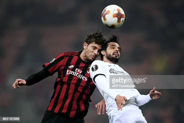 AC Milan's midfielder Manuel Locatelli fights for the ball with AEK's defender Helder Lopes from Portugal during the UEFA Europa League football...
