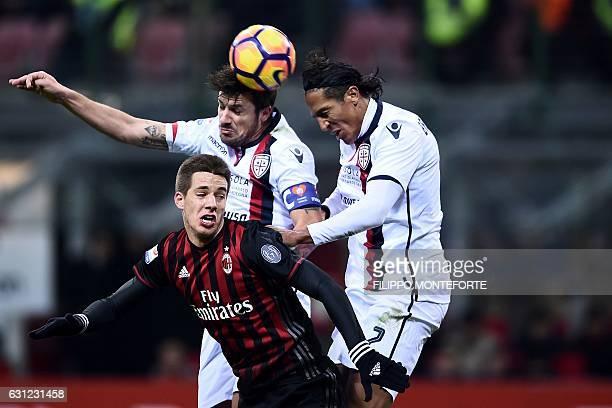 AC Milan's midfielder of Croatia Mario Pasalic vies with Cagliari defender of Portugal Bruno Alves and midfielder of Italy Nicolo Barella during the...