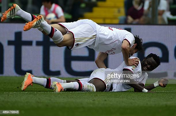 AC Milan's midfielder of Ghana Sulley Ali Muntari and AC Milan's Brazilian forward Kaka celebrate after Atalanta's defender Giampaolo Bellini scores...
