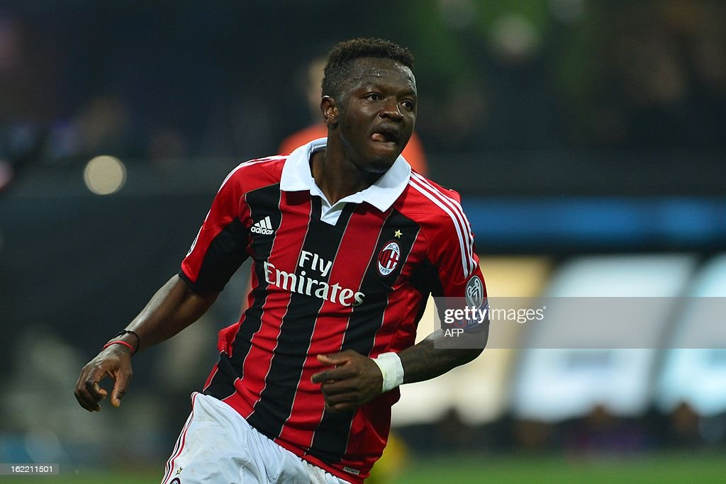 AC Milan's midfielder of Ghana Sulley Ali Muntari celebrates after scoring during the Champions League football match between AC Milan and FC Barcelona on February 20, 2013 at San Siro Stadium in Milan.
