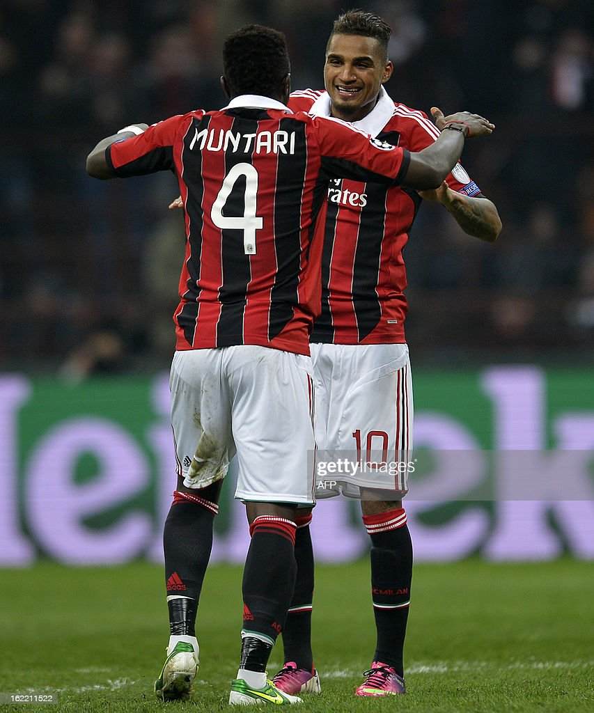 AC Milan's midfielder of Ghana Sulley Ali Muntari (L) celebrates with teammate Kevin Prince Boateng scoring during the Champions League football match between AC Milan and FC Barcelona on February 20, 2013 at San Siro Stadium in Milan. AFP PHOTO / ALBERTO LINGRIA