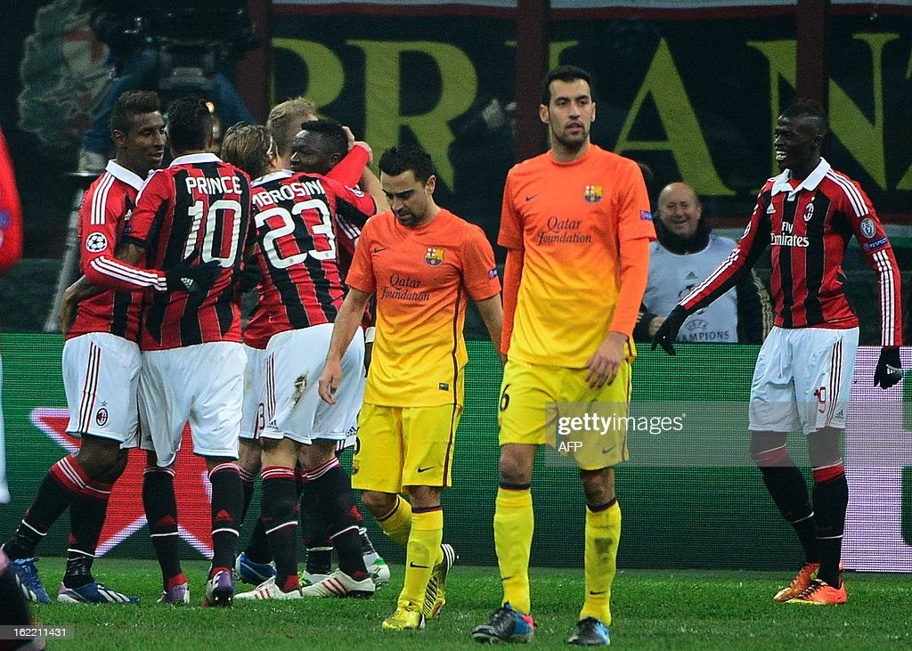AC Milan's midfielder of Ghana Sulley Ali Muntari (L) celebrates with team mates after scoring during the Champions League football match between AC Milan and FC Barcelona on February 20, 2013 at San Siro Stadium in Milan. AFP PHOTO / OLIVIER MORIN