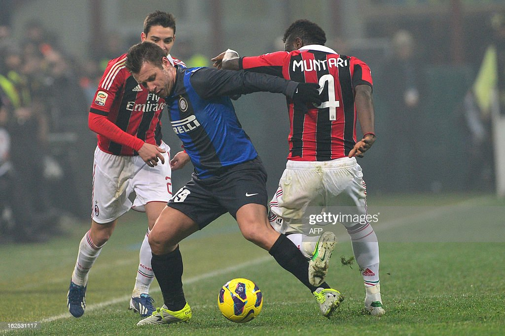 AC Milan's midfielder of Ghana Sulley Ali Muntari (R) challenges for the ball with Inter Milan's forward Antonio Cassano during their the Serie A football match between Inter Milan and AC Milan at San Siro Stadium in Milan on February 24, 2013.