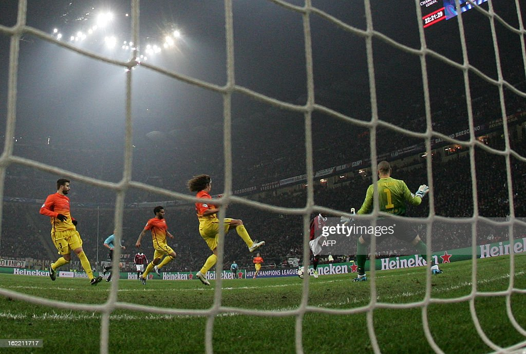AC Milan's midfielder of Ghana Sulley Ali Muntari (C) scores during the Champions League football match between AC Milan and FC Barcelona on February 20, 2013 at San Siro Stadium in Milan.