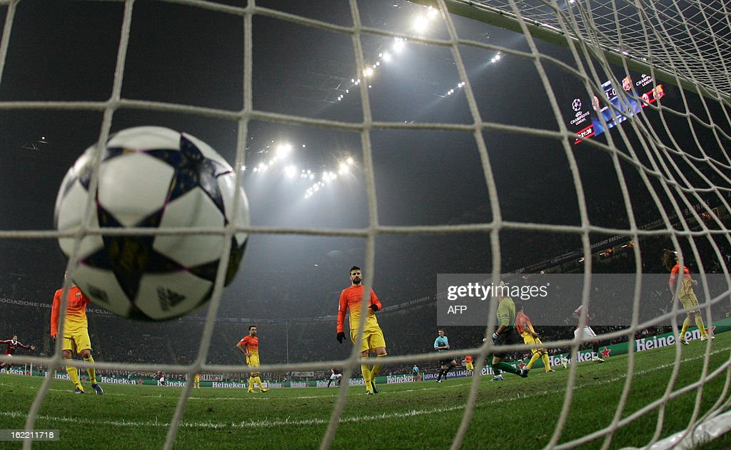 AC Milan's midfielder of Ghana Sulley Ali Muntari scores during the Champions League football match between AC Milan and FC Barcelona on February 20, 2013 at San Siro Stadium in Milan. AFP PHOTO / ALBERTO LINGRIA