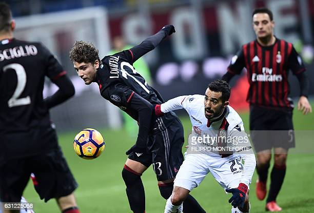 AC Milan's midfielder of Italy Manuel Locatelli vies with Cagliari forward of Italy Marco Sau during the Italian Serie A football match AC Milan vs...