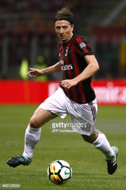 AC Milan's midfielder Riccardo Montolivo controls the ball during the Italian Serie A football match between AC Milan and Cagliari on August 27 2017...