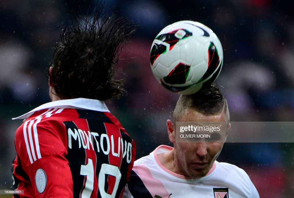 AC Milan's midfielder Riccardo Montolivo (L) fights for the ball with Palermo's Slovenian midfielder Jasmin Kurtic during the serie A football match between AC Milan and Palermo, on March 17, 2013 in Milan, at the San Siro stadium.