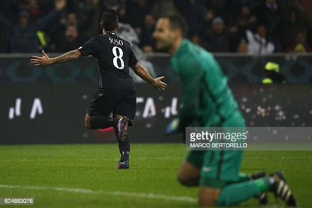 AC Milan's midfielder Suso from Spain celebrates after scoring during the Italian Serie A football match AC Milan Vs Inter Milan on November 20 2016...