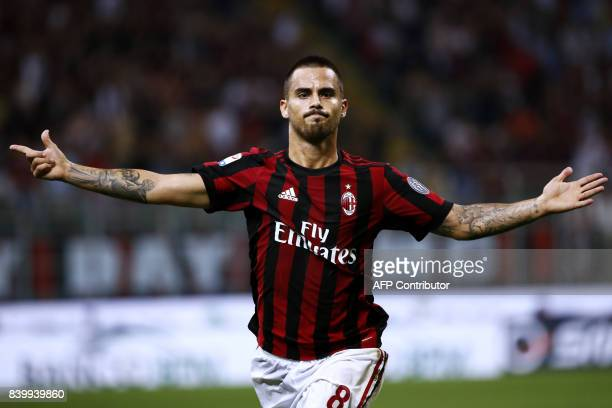 AC Milan's midfielder Suso from Spain celebrates after scoring during the Italian Serie A football match AC Milan Vs Cagliari on August 27 2017 at...
