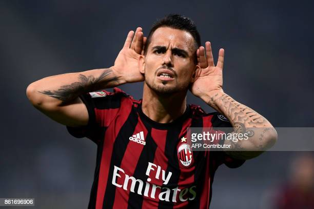 AC Milan's midfielder Suso from Spain celebrates after scoring during the Italian Serie A football match Inter Milan Vs AC Milan on October 15 2017...
