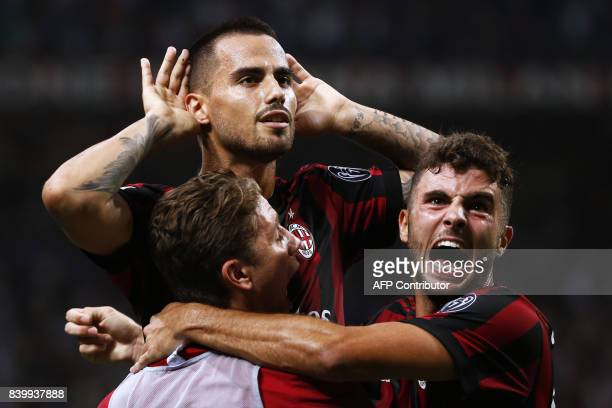 AC Milan's midfielder Suso from Spain celebrates after scoring with his teammate AC Milan's forward Patrick Cutrone during the Italian Serie A...