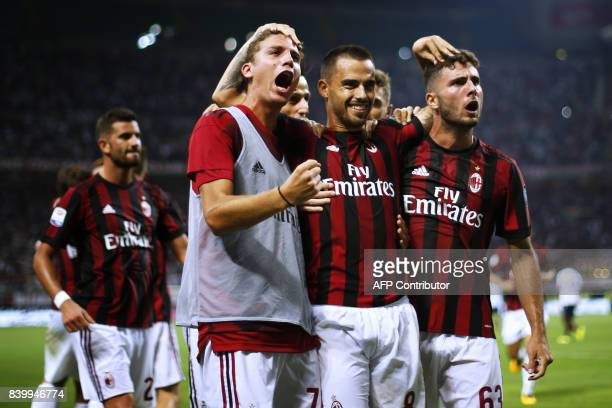 AC Milan's midfielder Suso from Spain celebrates after scoring with his teammates during the Italian Serie A football match AC Milan Vs Cagliari on...