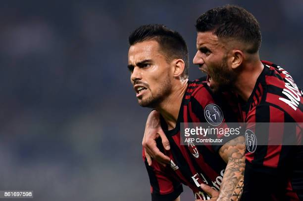 AC Milan's midfielder Suso from Spain celebrates with teammate Mateo Musacchio after scoring during the Italian Serie A football match Inter Milan Vs...