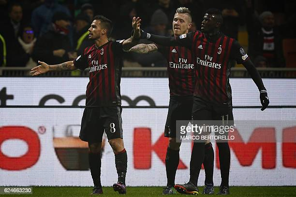 AC Milan's midfielder Suso from Spain celebrates with teammates after scoring during the Italian Serie A football match AC Milan Vs Inter Milan on...