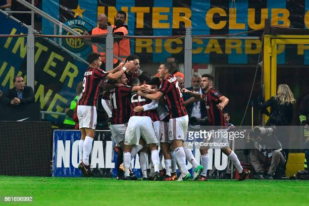 AC Milan's midfielder Suso from Spain celebrates with teammates after scoring during the Italian Serie A football match Inter Milan Vs AC Milan on...