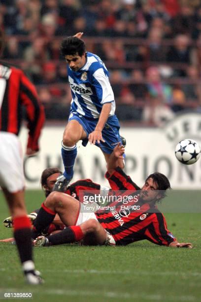 AC Milan's Paolo Maldini and Gennaro Gattuso combine to tackle Deportivo La Coruna's Juan Valeron
