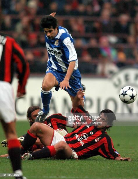 AC Milan's Paolo Maldini and Gennaro Guttuso tackle Deportivo La Coruna's Juan Valeron