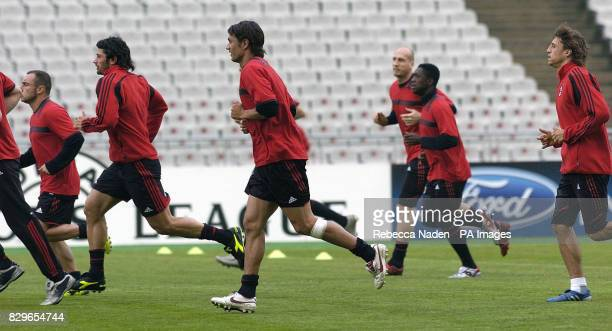 AC Milan's Paolo Maldini followed by Hernan Crespo warm up during a training session
