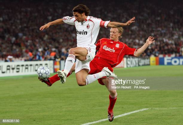 AC Milan's Paolo Maldini jumps in to tackle Liverpool's Dirk Kuyt