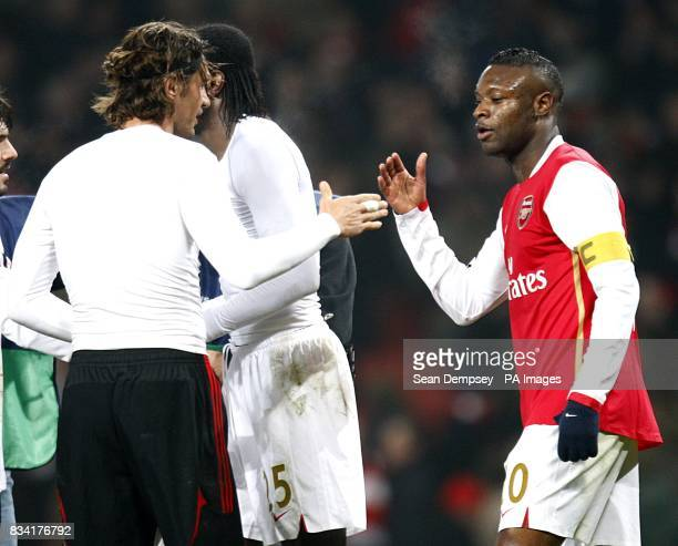 AC Milan's Paulo Maldini and Arsenal's William Gallas after the final whistle