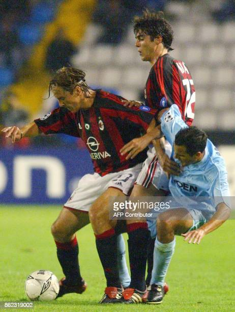 AC Milan's player Massimo Ambrossini fights for the ball with Celta Vigo's Angel Lopez during the Champions League match in Balaidos stadium in Vigo...