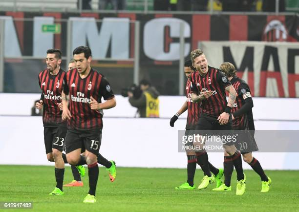 AC Milan's players celebrate after AC Milan's Slovanian midfielder Juraj Kucka scores during the Italian Serie A football match between AC Milan and...