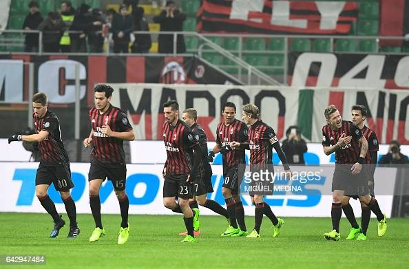 AC Milan's players celebrate after AC Milan's Slovanian midfielder Juraj Kucka scores during the Italian Serie A football match between AC Milan and...