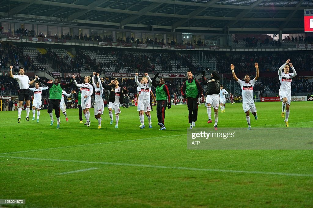 AC Milan's players celebrate at the end of the Italian Serie A football match between Torino and AC Milan at the Olympic Stadium in Turin on December 9, 2012.