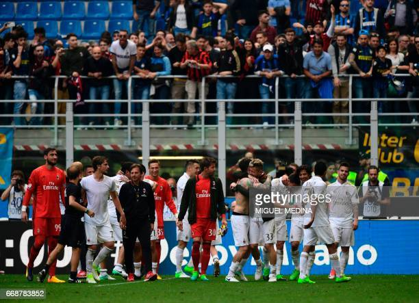 AC Milan's players celebrate at the end of the Italian Serie A football match Inter Milan vs AC Milan at 'San Siro' Stadium in Milan on April 15 2017...