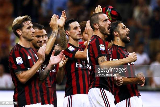 AC Milan's players celebrate at the end of the Italian Serie A football match AC Milan Vs Cagliari on August 27 2017 at the 'Giuseppe Meazza' Stadium...