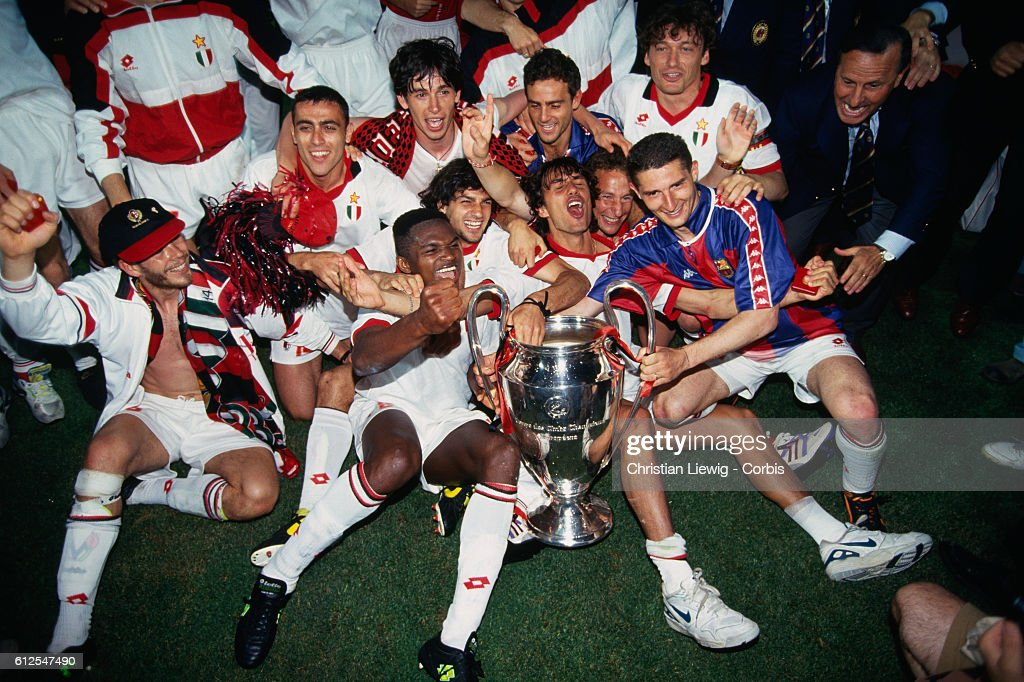 Milan's players celebrate with trophy after they won the 1994 UEFA Champions League final against FC Barcelona 4-0.