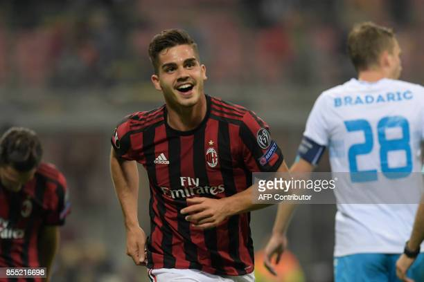 AC Milan's Portuguese forward Andre Silva celebrates after scoring during the UEFA Europa League football match AC Milan vs HNK Rijeka at the San...