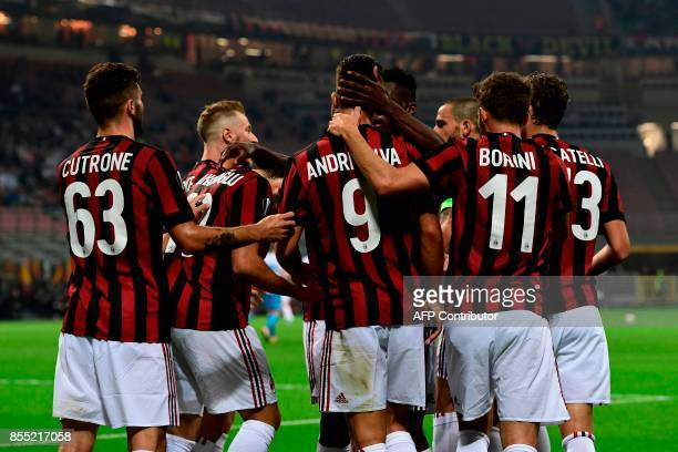 AC Milan's Portuguese forward Andre Silva celebrates with teammates after scoring during the UEFA Europa League football match AC Milan vs HNK Rijeka...