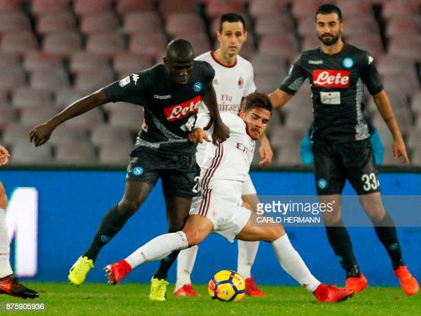 Milan's Portuguese forward Andre Silva fights for the ball with Napoli's French defender Kalidou Koulibaly during the Italian Serie A football match...