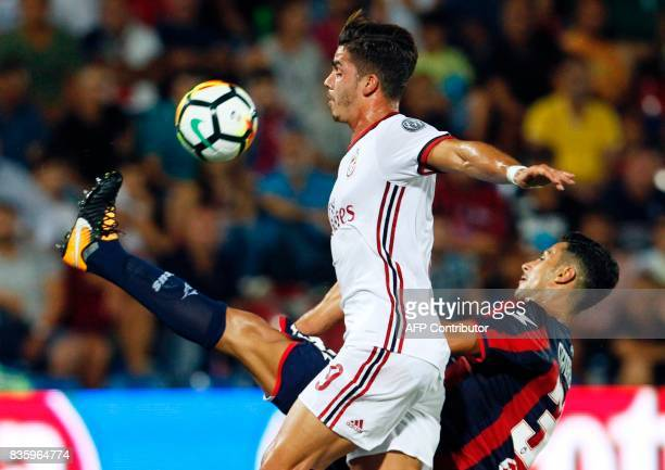 Milan's Portuguese forward Andre Silva vies for the ball with Crotone's Italian goalkeeper Marco Festa during the Italian Serie A football match FC...