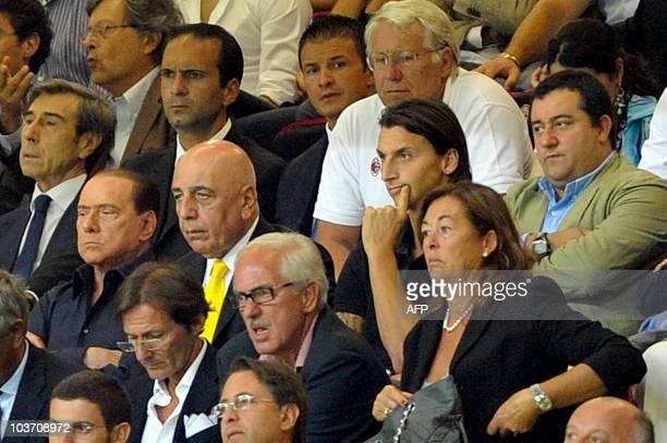 AC Milan's president Silvio Berlusconi AC Milan's sporting director Adriano Galliani AC Milan's Swedish forward Zlatan Ibrahimovic and his manager...
