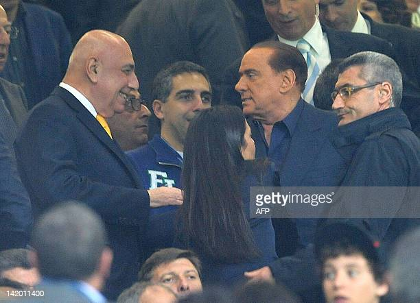 AC Milan's president Silvio Berlusconi is greeted by AC Milan's sporting director Adriano Galliani prior the Champions League quarterfinals football...