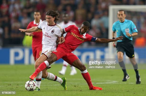 AC Milan's Riccardo Montolivo and PSV Eindhoven's Georginio Wijnaldum battle for the ball