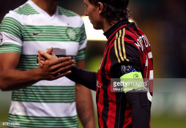 AC Milan's Riccardo Montolivo shakes hands with Celtics players