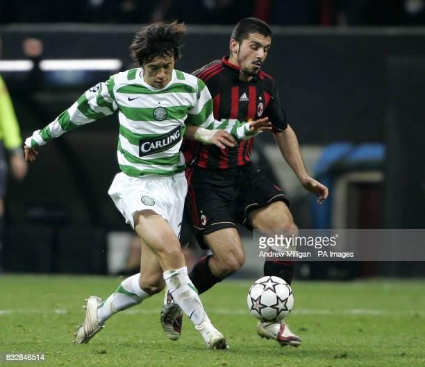 AC Milans Rino Gattuso challenges Celtics Shunsuke Nakamura during the Champions league match AC Milan vs Celtic at the San Siro Stadium in Milan...
