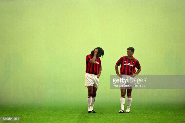 AC Milan's Ruud Gullit waits for the smoke to clear with Mauro Tassotti