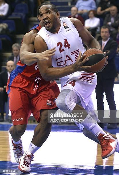 Milan's Samardo Samuels vies with CSKA Moscow's Kyle Hines during the Euroleague Top 16 group F basketball match CSKA Moscow vs Ea7 Emporio Armani...