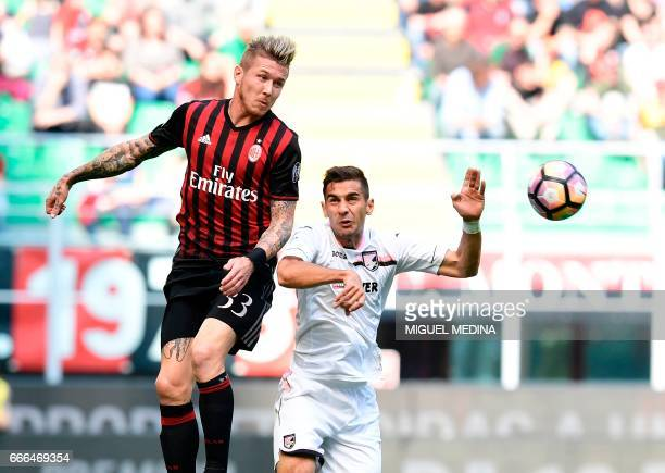 AC Milan's Slovanian midfielder Juraj Kucka vies with Palermo's Italian forward Alessandro Diamanti during the Italian Serie A football match AC...