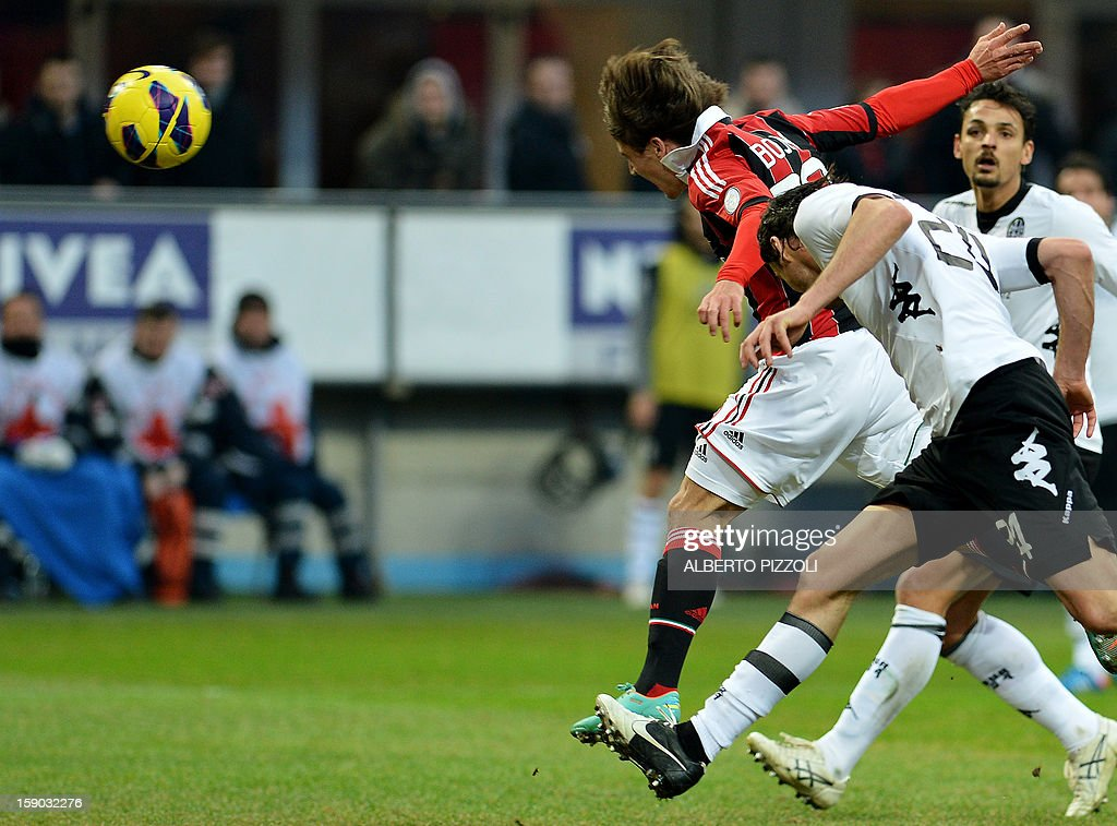 AC Milan's Spanish forward Bojan Krkic (2nd R) heads the ball to score during the Italian Serie A football match between AC Milan and Siena on January 6, 2013, at San Siro stadium in Milan.