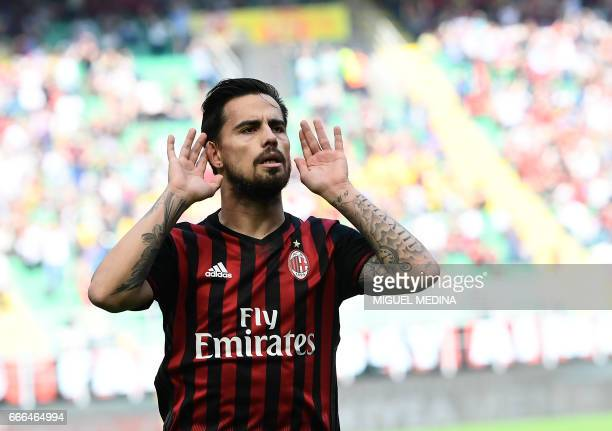 AC Milan's Spanish forward Fernandez Suso celebrates after scoring during the Italian Serie A football match AC Milan vs Palermo at the San Siro...