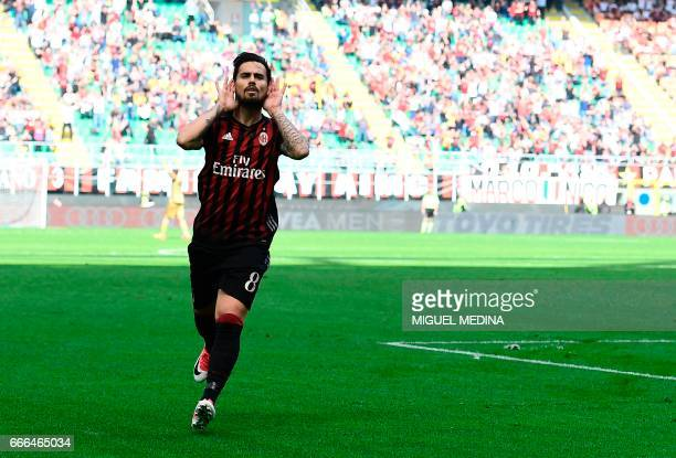 AC Milan's Spanish forward Fernandez Suso celebrates after scoring during the Italian Serie A football match AC Milan vs Palermo at the San Siro...