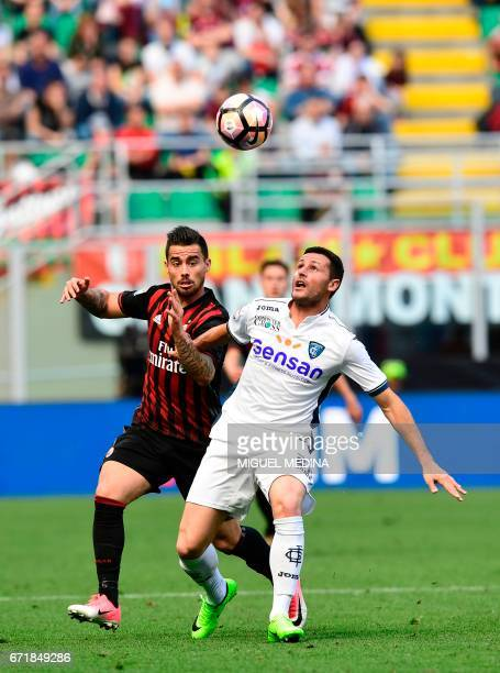 AC Milan's Spanish forward Fernandez Suso vies with Empoli's Italian defender Manuel Pasqual during the Italian Serie A football match AC Milan vs...